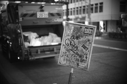 sign & garbage truck